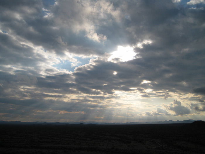 Sun rays shining through the clouds over the Harquahala Plain