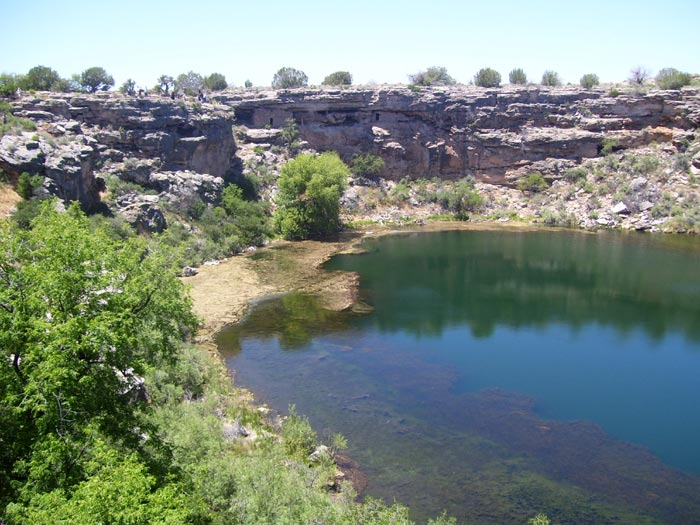 Montezuma Well with cliff dwellings on the far side