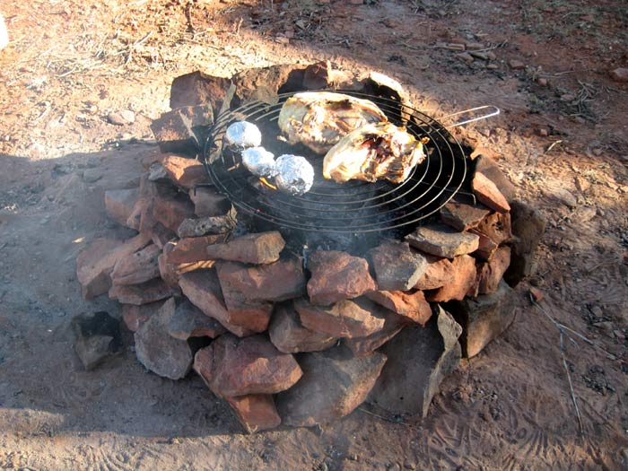 It's chicken and potatoes on the red rock barbecue tonight! Picture taken at Red Tank Draw southwest of the intersection of FR-618 and FR-121.