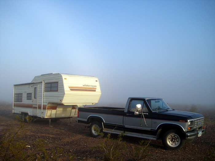 RV boondocking with thick morning fog after a day of rain
