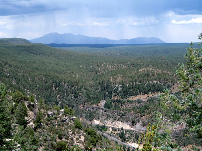 San Francisco Mountain near Flagstaff is off in the distance and US Highway 89A, before it drops into Oak Creek Canyon, is below. Photo taken from Harding Point on the west rim.