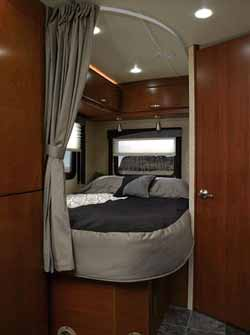 Fulltime corner bed on the Jamboree DSL Sprinter motorhome